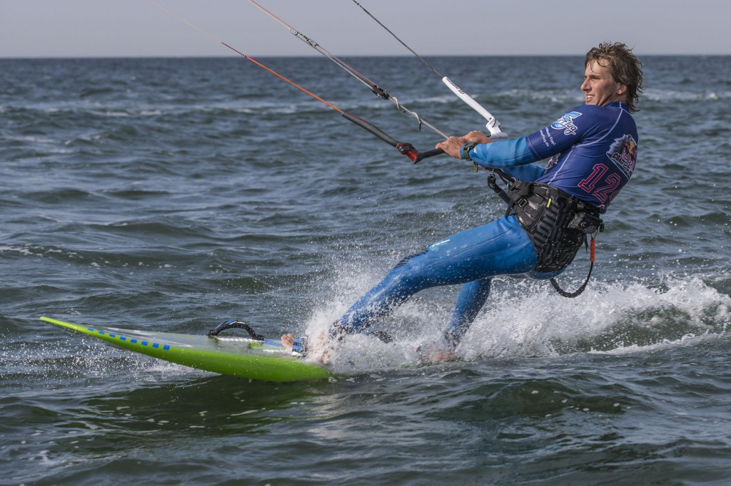 Event participants perform at Red Bull Coast 2 Coast, the worlds longest kite surf race in history with more than 300 participants, at Niobe beach on the island Fehmarn, Germany on September 7 2013.