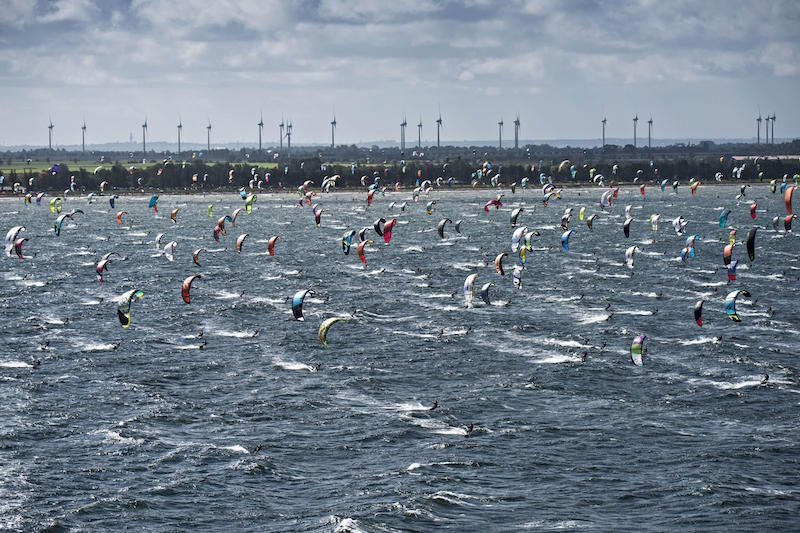 Event participanta perform at the Red Bull Coast 2 Coast, the worlds toughest kite surf marathon in history with more than 500 participants, at Niobe beach on the island Fehmarn, Germany on September 20 2015.